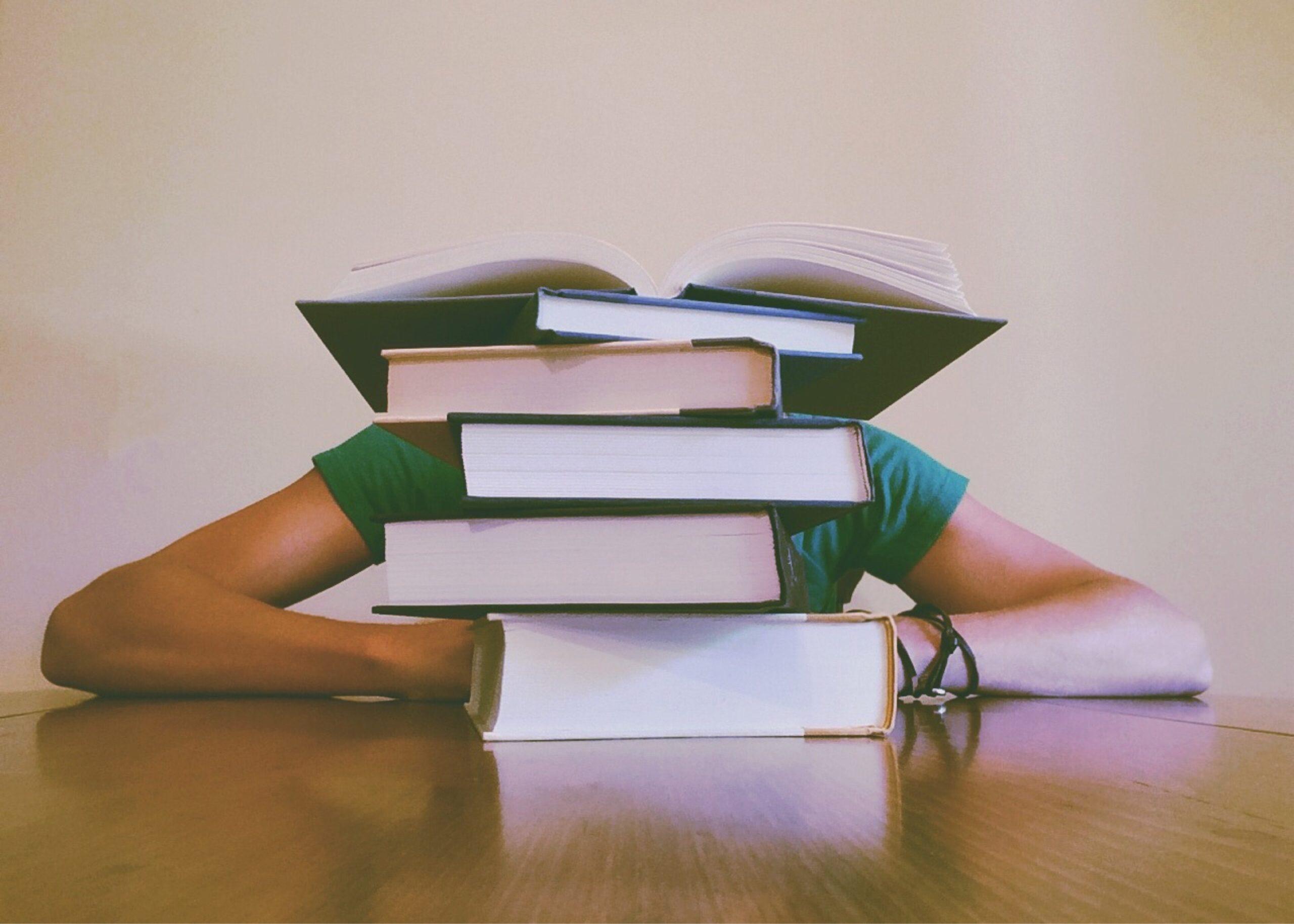 adult-blur-books-close-up-261909