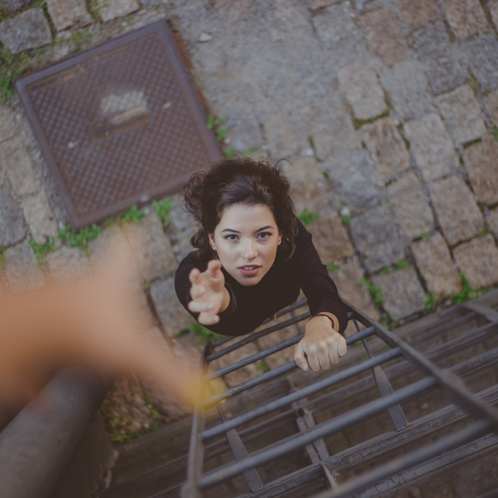 high-angle-photo-of-woman-on-ladder-2467396