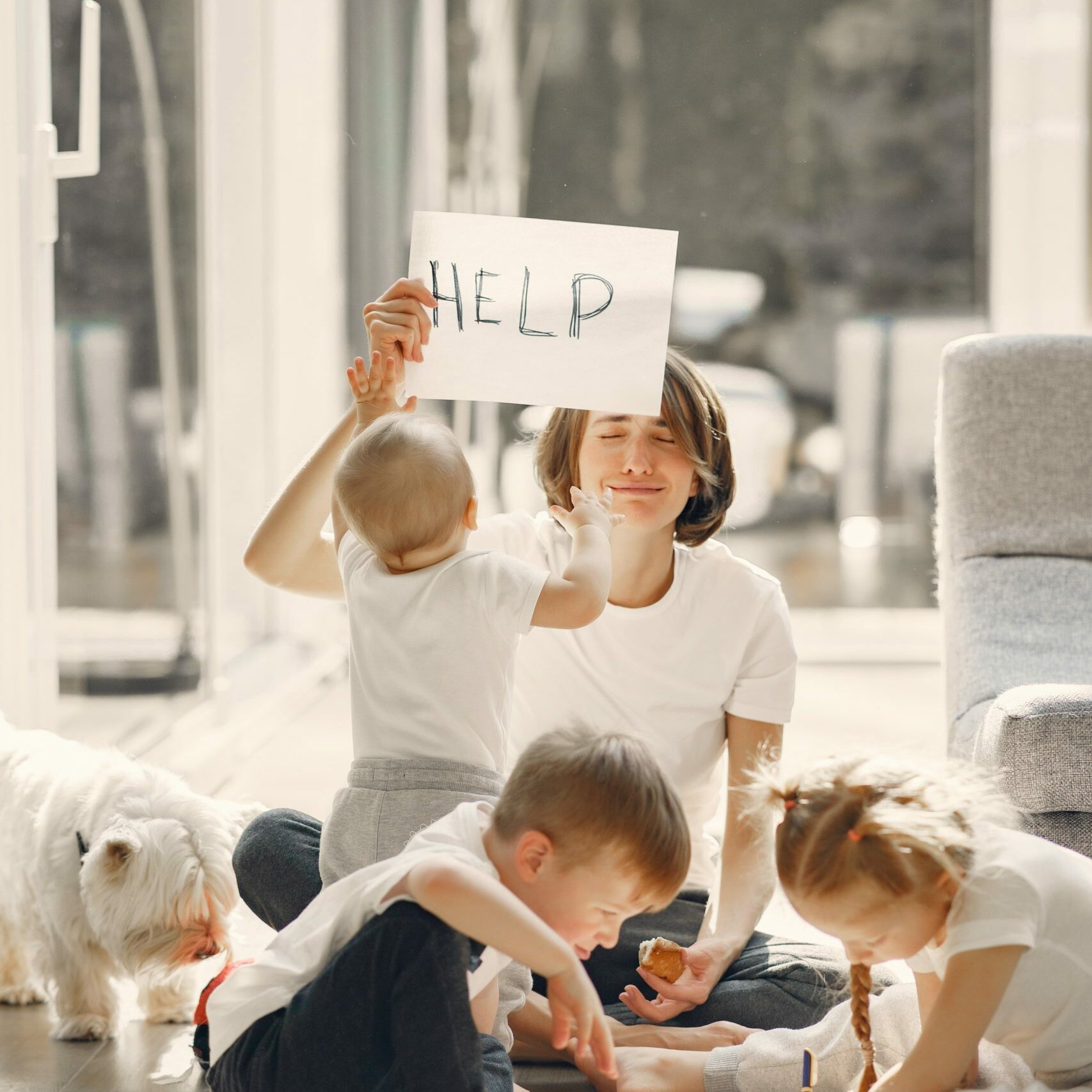 tired-mother-kidding-while-sitting-with-children-4017413